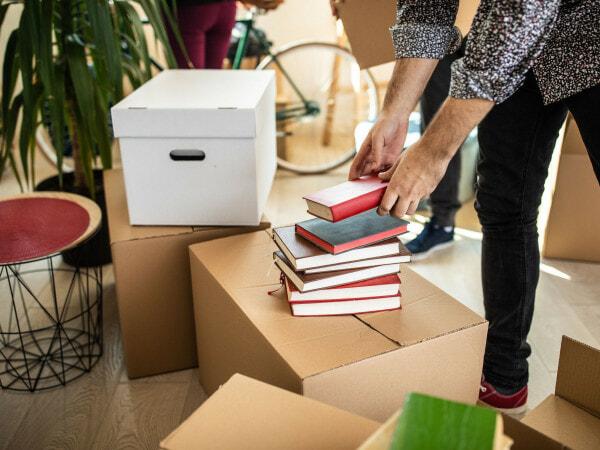 Pile Of Books On Cardboard Box 1132293139 0135Ce971Ea24D7F8271756Dd2B65664